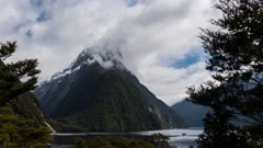 a time lapse of clouds swirling around the summit of mitre peak in milford sound