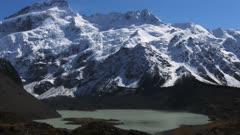 a panning shot of mt sefton, mueller glacier and lake mueller in mt cook/aoraki national park in new zealand