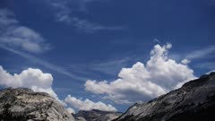 cumulonimbus clouds build above the mountains of the high sierras near tuolumne meadows, yosemite