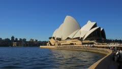 crowds of tourists visit the sydney opera house