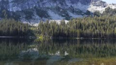 a calm summer morning at lake tenaya in the high sierras of yosemite national park