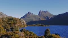 sunset shot of cradle mountain with glacier rock and dove lake in tasmania, australia