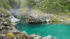 misty morning shot of a beautiful gorge on the crystal clear caples river in new zealand,