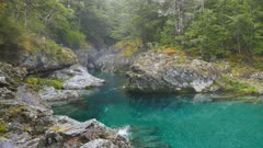 a zoom in shot of a beautiful gorge on the stunning caples river in new zealand,