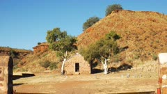 a zoom in shot of an old hut and ghost gums at the overland telegraph station, barrow creek in australia's northern territory