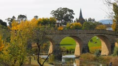 high angle view of the historic old stone bridge in richmond and the spire of australia's oldest catholic church still in use