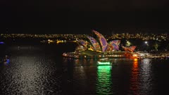 sydney harbour and the opera house brightly lit up during the vivid festival 2015