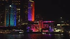 close up of circular quay in sydney brightly lit with coloured lights during the vivid festival 2015