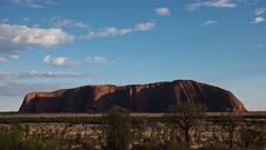 a morning time lapse of clouds moving over uluru viewed from the sunrise viewing area