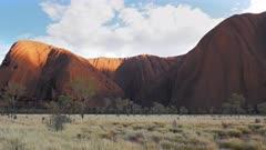 a panning close up of uluru at mutijulu in australia's northern territory