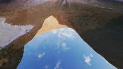 a panning close up of  mutijulu waterhole at uluru/ayers rock in australia