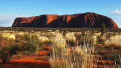 an early morning view of uluru from the sunrise viewing area