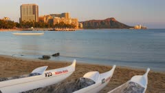 outrigger canoes with waikiki beach and diamond head in the background