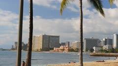 a long shot of waikiki beach and the royal hawaiian hotel on the island of oahu, hawaii