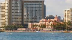 the famous waikiki beach and the historic royal hawaiian hotel on the island of oahu, hawaii