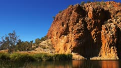 panning shot of glen helen gorge in the west macdonnell ranges near alice springs