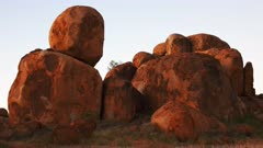 a panning view of the devil's marbles in australia's northern territory at sunrise