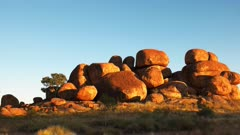 the devil's marbles and sunbeams at sunrise