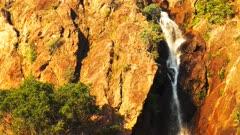 a vertical panning shot of wangi waterfalls in litchfield national park near kakadu