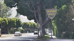 beverly hills sign in los angeles with traffic