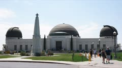 exterior view of griffith observatory in the hollywood hills, california. griffith observatory is a facility in los angeles