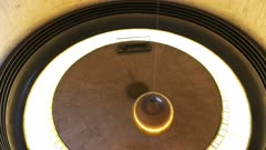 close up of the foucault pendulum at griffith observatory, a foucault pendulum is designed to demonstrate the rotation of the earth
