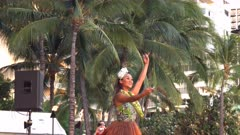 a tourist photographs a hula dancer performing at waikiki, hawaii