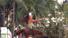 slow motion close up of a hula dancer performing at waikiki