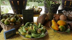 a variety of fresh fruit for sale at a roadside stand on the road to hana, maui