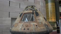 a close up view of the apollo 11 command module on display in the national air and space museum