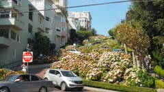 wide view of cars winding their way down lombard street in san francisco, california
