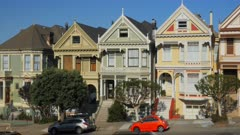 a panning right view of the painted ladies houses in san francisco, california