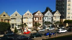 a 3 axis gimbal shot of walking up the street with the painted ladies houses in san francisco, california