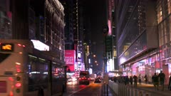 the view looking down 42nd street in new york towards times square on a saturday night