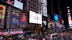 a wide angle pan of the crowds and lights of times square in new york
