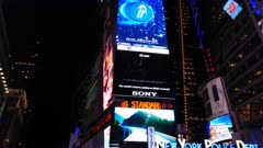 low angle close up pan of the advertising boards and buildings in times square, new york