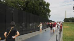visitors at the vietnam memorial in washington, dc