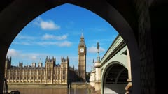 big ben framed by the arch of a bridge in london, england