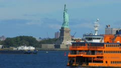 close up of the famous staten island ferry with the statue of liberty in the background