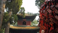 close up of the bell tower inside beihai park, beijing and wooden fu