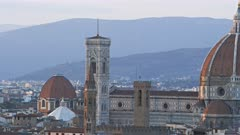 panning left to right shot of the duomo in florence, a famous cathedral designed by filippo brunelleschi