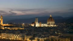 dusk shot of the duomo and florence in italy, from piazzale michelangelo