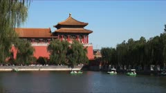 holidaymakers ride paddle boats outside the forbidden city, beijing during the national day golden week