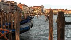 gondolas tied up at piazza san marco, venice at sunset