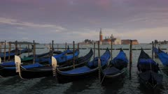 sunset view of gondolas at piazza san marco, venice