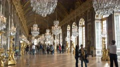 tourists pose for a selfie photograph in the hall of mirrors in the château of versailles, paris