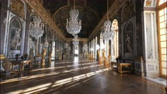 a late afternoon view of the opulent hall of mirrors in the palace of versailles, paris