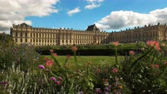 the gardens and palace at the chateau of versailles in paris, france