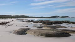 a left to right panning view looking north at eddystone point in the bay of fires region on the east coast of tasmania