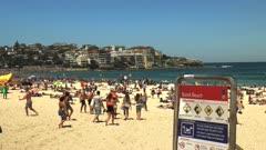 sydney australia's famous bondi beach and sign looking north
